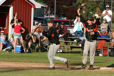 Celebration begins as two winning pitchers for the day - Marty Cozart (left) and Connor Craft #28 share the last out of regionals - advancing the Tigers to the final four in Yakima.