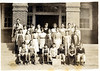 "Alapaha Public School, 1934, Grade 7. <br /> Top Row: W. M. Powell, J. F. Rice, Marie Hayes, Mary Julia Lewis, Merle Golden, Clarence Alexander, Maggie Selph, John D. Moore, Emory Rowe, Mrs. Prescott, Wylmoth Alexander,<br /> 2nd Row: Wilson Moore, Willa Mae Jernigan, Mary Miller, Doris Soloman, Dalpha Flanders, Othel Cribb, Quillian Golden, and Carl ""Beck"" Spurlock.<br /> Bottom Row: Felton Griffin, Homer Purvis, John H. Selph, Clinton Barrineau, Brantley Seymore, Edwin Gaskins, Perry Jacobs<br /> Photo courtesy of Edwin Gaskins"