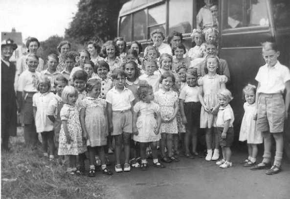 <font size=3><u> - Children's Group by Bus -  </u></font> (BS0003)  Sunday School outing.   Granny Aldridge Sunday School Outing.  19???. Granny on the extreme left. Gladys Hodgins is next to her.