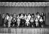 New Jordan School, 3rd Grade, 1953-54<br /> Front row, L-R: Walter Groves, Linda Kay Ray, Charles Bryan, Betty Ann Clark, Joe Walsh, Linda Hesters, Hershel Womack, Carolyn Bryan, Carlos Walker. Back row, L-R: Arnold White, Bunny Baker, Pam Gaskins, Leroy Nosworthy, Faye Lovett, Emory Guess, Faye Ivey, Thomas Lokey, Laverne Bryan, Steve Harrell, Cecil ____, Teacher, Miss Camillia Paulk.