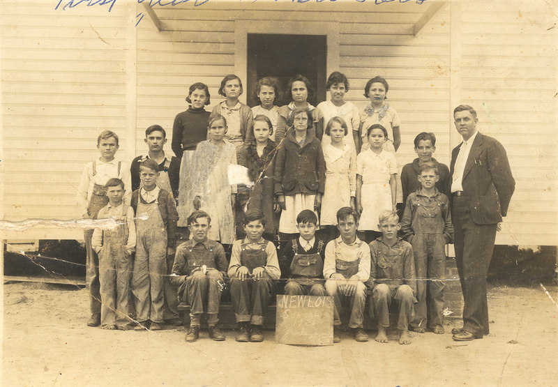 New Lois consolidated school, 4th, 5th, 6th Grades, 1933-34 the first year the school was opened. Identified front row left to right: Lucian Parrish, William Forehand, Elby Ray, –––––––– Buckholt, Lamar Weaver, Ronald Parrish, Alton Akins, Pete Akins, Bernys W. Peters. Second row: Amos Luke, C.H. Ray, Lucille Knowles, Camilla Comer, Enda Fountain, Rudelle Lee, Alma Luke, Clementine Mickell. Back row: Hazel Sirmans, ––––––– Fountain, Myrtice Jordan, Helen Griffin, Verna Jordan, Lawanna Griffin.