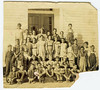 Gaskins Consolidated School, 1936-37, Grades 4th and 5th. Students identified: Curtis Cook, top row, 6th from the left; Carlie Cook, front row, 5th from the left holding sign. Teacher is Estell Paulk. Identification of other students needed. Contact Berrien Historical Foundation.<br /> Photo courtesy of Dorothy Boyd Cook