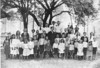 Live Oak School, circa 1907. School was located on Bud Hendley farm.<br /> Front,L-R: Alice King, Kathryn Herring, Bea Bennett, Oscar Herring, Bud Baker, Lula King, Edna Herring, Louis Herring, Floyd Smith, Jimmy Herring, Byrd Griner, Ben Baker, Blanch Cox, Jay Hendley, Mac Hendley, Lint Griner, Mallie Faulkner, Cora Hendley, Hugh Smith Smith, Lilla King, W. T. Vickers.<br /> Second row, L-R: Math Hendley, Bernice Smith, Leonard Parr, Sally Cox, Alvin Baker, Don Luke, teacher, John Smith, James Coon, Arthur Rowe, Willie Coon, Isaac Rowe, Jeannie Rowe, Ed Tice, Annie Bell Cox.<br /> Third Row, L-R: Holt Hendley, John Rowe, Miles Sutton, Jake Parr, and in the background are some of the parents. (Courtesy of Julie Hendley and The Berrien Press)<br /> <br /> This photo appeared in the Down Memory Lane column of The Berrien Press on January 4, 1968.