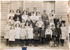 Mathis School about 1910. Identified in the photo are the first two girls on the front row left, Irene Gray Flanders, and Becky Stewart. Photo courtesy of Bonnie Purvis