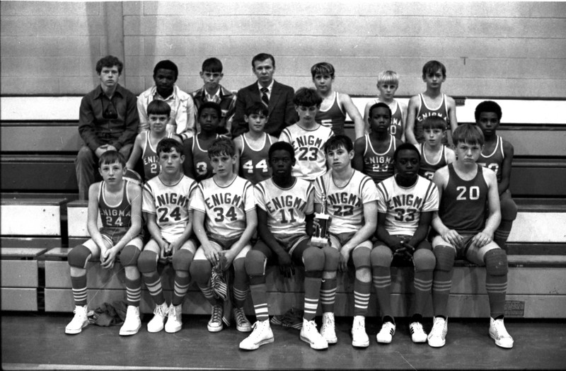 1970-71 Enigma Boys Basketball Team<br /> <br /> The Berrien Press, page 11, March 11, 1971<br /> Photo caption:<br /> SECOND PLACE – Lacking in size, but not in determination and hustle were the Enigma boys who took the runner-up trophy at the county tournament last week.  Sorry, boys, but the notes with the identification was misplaced, but the action shown promises that the names will be familiar to basketball fans in the years to come.