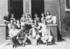 Enigma High School 10th Grade, 1943-44<br /> Left to Right:<br /> Front Row: Raymond Goff, Bennett Willis, Raymond Lyles, Hilton Easters.<br /> Middle Row:  Betty Sumner, Geneva Barnes, Joyce Lee, Lucille Webb, Zelda Jernigan.<br /> Top Row:  Mrs. Williams, Teacher;  Mellie Griffin,  Allean Conger,  Elwanda Henderson, Thedis Luck, Jean Smith, Leola Little.