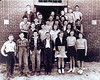 1944-45 Enigma, Ga. 6th Grade Class<br /> Names of Students:<br /> L. to R.-<br /> Front Row: Robert Smith, LaVerne Little, ____Pitts, Aaron Welch, Ruth Smith, Betty Jo Clements, Daphne Cauthen.<br /> 2nd Row: Raymond Railey, Donald Henderson, Donnell Henderson, Carolyn Hall.<br /> 3rd Row: Marvin Johnson, Rossie McMillan, Ernest Pickard, Betty Ann Lee, Mary Edna Fogarty, W. D. Mason.<br /> 4th Row: Elbert Kilcrease, Russell Smith, Anna Faye Chambless, Lucile Terry.<br /> Back Row: Joe Baker, Audrey Dillard, Gwendolyn Ashley, Monteal Gibbs, Ray Stewart, Winston Sumner.