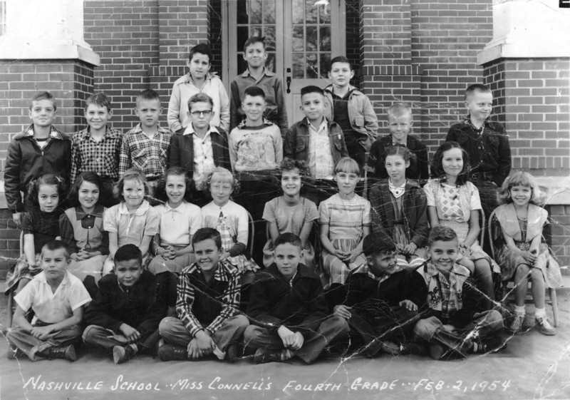 Miss Connell's 4th grade class, Feb 2, 1954<br /> Front Row, left to right: Jimmy McMillan, Jimmy Young, Emerson Harper, Jackie Richardson, Densil Calhoun, Dewey May.<br /> 2nd Row, left to right: Wanda Bennett, Jane Gaskins, Marilyn Breowning, ______  ______, Sally O Berry, Anita McCorvey, Thelma Harper, Ouida Ray.<br /> 3rd Row, left to right: Danny Lewis, ______  ______, Wayne Harris, Olin  ______, Charles Hughes, ______ O Berry, Martin McClellan.<br /> 4th Row, left to right: Donald Warren, Terry Hamby, Jack Parker<br /> Information needed on identification of other students.