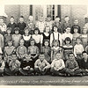 "Mrs. Mamie Richardson 2nd Grade Class, 1954. <br /> Front row: ___, Herman Harper, Norris McNabb, Larry Kent, Stanley Vickery, Ronnie Guthrie, Earl Lewis.<br /> 2nd Row: Susan Webb, ___, Jo Ann Hodges, Phyllis Browning, ___, Linda Griffin, Anna Sue Tyson, ___, Pat Shirah.<br /> 3rd Row: ___, Judy Miller, ___, Melba McGee, ___, ___, Jackie Barber, Glenna Jo Durrance, Janice Browning, Sara Lee Rowland, Judy Anderson.<br /> Back Row: Bob Lovein, Edward Rowan, Buddy Lindsey, Wynn Hancock, Larry Kelly, Jimmy Young, Billy (Bobby) Clyatt, William H. Outlaw Jr.(= Bill Outlaw , Billy Outlaw), Billy Bailey (Courtesy of William H. ""Bill"" Outlaw)"