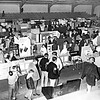 The Berrien Press, front page, February 27, 1969<br /> Photo caption:<br /> SOCIAL STUDIES FAIR – After months of preparations, students of Nashville Elementary School and Berrien High School had their projects on display at Christie Bragdon Gym last week.  Out-of-town judges reviewed the projects and awarded red, white, and blue ribbons, with the blue ribbon winners advancing to the district competition.  Some of the large number of those viewing the exhibits are shown wending their way through the narrow, congested passages.