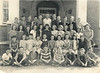 "1949-50 7th Grade Class of Mrs. Alton Futch<br /> 1st Row L to R: Earl Smith, raymond Stone, Garland McMillan, Joe Shaw, Bobby Hall, Horace Brown, Harold Strawder, Max Gaskins<br /> 2nd Row L to R: Bobby Allen, Delores Bridges, Cassie Lynch, Eve Mae McLemore, Carrie Ann Bostic, unknown, Faye Williams, Patsy Fountain, Louise Adams, Homer Grimes<br /> 3rd Row L to R: Virginia Blount, Nancy Jefferson, Beverly Sue Barfield, unknown, unknown, Joyce Singletary, Ester Studavant, Elaine Carter, Martha Taylor, Lois Gunter, Anita Prickett, Mrs. Alton Futch<br /> 4th Row: Raymond Shaw, Earl Faulkner, Franklin Winder Weedle, Kenneth Roberts, Charles Bryan, Harold Wayne Griffin, Robert Parramore, unknown, Wendell ""Sonny"" Nix, Ralph Boyd, Junior Futch.<br /> Photo courtesy of Frances Gray Plair (Identifications needed)"
