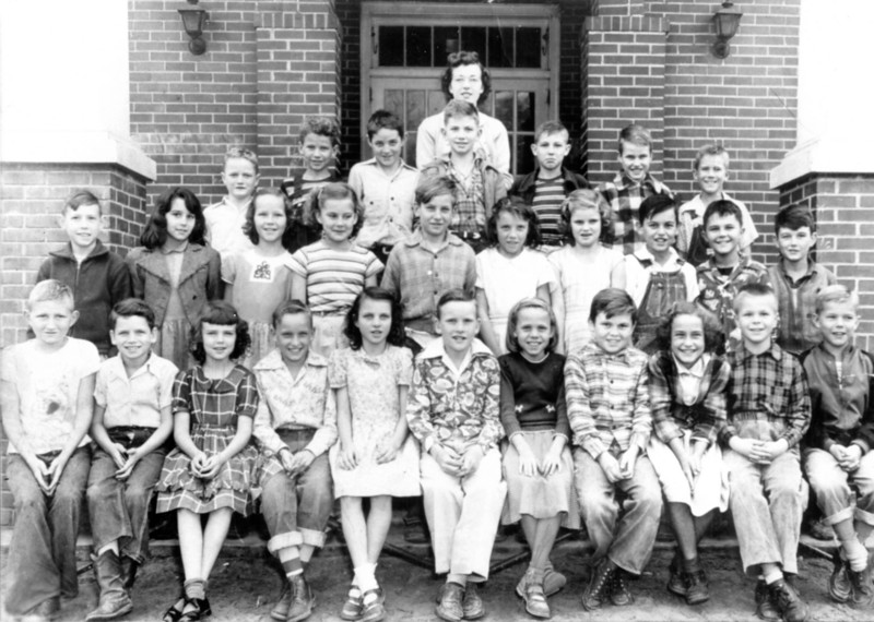 Nashville Elementary School, 1949-50, 4th Grade Class, Miss Jean Dixon<br /> Please help identify.<br /> Known: Front row, left to right: unknown, unknown, June Hughes, unknown, Betty Brown, Jimmy Roberts, unknown, unknown, Latrelle Warren, William Waugh Turner III, J.A. Bennett; 2nd row, left to right: Earl Anderson, unknown, unknown, Sara Perry, unknown, unknown, unknown, Tommy Parramore, Russell Gray; 3rd row, left to right: Travis King, unknown, Damon Stone, Dawson Mathis, unknown, unknown, Julian Lindsey. Teacher Jean Dixon (Send information to berriencountyga@alltel.net)