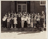 NES, 1952-53, 1st Grade Class, Ms. Joella Johnson (daughter of Mrs. Eunice Johnson).<br /> Front fow: Butch Brown (in uniform), Chip Yancey, Wendell Rogers (whose father made the photograph), Barbara McGill, Stanley Vickery, Phyllis Browning. William H. Outlaw Jr. (Bill Outlaw, Billy Outlaw)--back row first male from left. (Photo courtesy of Bill Outlaw)