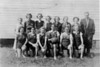 The 1936-37 Nashville High School Girls Basketball Team<br /> Front row, left to right: Peggie E'Dalgo, Dollie Bouterse, Mary Perry, Marie Mathis (captain), Ruth Parrish, Sarah F. Phillips.<br /> Back row, left to right: Melba Rowan, Rhoda Gaskins, Marguerite Johnson, Grace Anderson, Johnny Mae Long, Sarah Griner, Emogene Rentz, and Coach W. B. Gaines.<br /> The team went to the finals in the District Tournament but Pearson won over them. They got second place in the District and third place in this and the adjoining district. There were four girls who made all-tournament. They were: Mathis and Bouterse as forwards, and Perry and Parrish as guards. Photo courtesy of Thomas Parr.