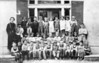 Nashville Public School, 1936-1937, 1st grade class of Ms. Effie Gene Brown, later Mrs. A.M. Shirley:<br /> Front row, L-R: N. L. Parr, M. T. Riggins, S. J. Stone, G. W. Lee, Clyde Cumbass, Rex Calhoun, Ancil Cumbass, Bill Green, L. C. Dekle, H. B. May, Floyce Lynch, Loyd Spires, Junior Wade.<br /> 2nd row, L-R: Nathan Taylor, Kathleen Lewis, Bonnie Roland, Anne Swain, Eloise Ray, Lena Belle Warren, Nell Griner, Patsy Webb, James Alvin Harnage, Alfred Brogden, Clayton Lynch, Audrey Gray, Mary Ellen Gaskins, Billy Edalgo, Earney Wesley Harnage, Russell Bradford, B. H. Miller, Kathleen Richardson, Maxine Taylor, Hazel Fountain, Retha Mae Fountain, and Marvin Browning (Courtesy of Kenneth May, Sr.)