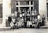 Nashville Public School 1936, 2nd Grade. Identified in the photograph:<br /> Front row, left to right: Edward McGraw, Joe Harvey, James Fender,————, Vernon————, ————, Earl Stewart, Billy Anderson, Bobby Mathis, Robert Griner, Henton Bennett, Jimmy Billy Moore.  Middle row, left to right: Bobby Berryhill, J. H. ————, Clara Gore, ————, ————, ————,————, ————, ————, Ellen ann Rockmore. Back row: Mrs. Annie Brown, teacher, Ann Tygart, Barbara ————, Doris Hendley, Hazel Smith, Frieda Levin, ————, Audrey Williams, Mary Marie Gaskins, Dot Pittman. Photo courtesy of Ann Tygart Jones. Other identifications needed.