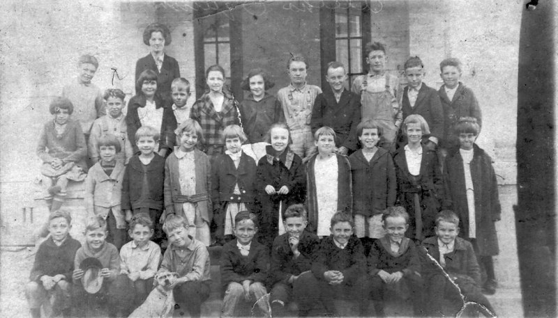 Ray City school about 1920. Identified: Second row 3rd from the right, Ida Lou Giddens Fletcher. Top row 2nd from the right, Ralph Sirmans.
