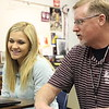 Round Rock HS teacher Roy Smith discusses events of the English Romantic Period with senior Marlena Brudeseth during a recent British Literature Dual Credit class
