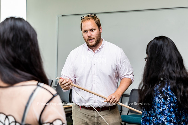 Dr. Michael von Fricken helps students put together tick drags as a group prepares for a trip to Kenya to collect ticks and mosquitos. Photo by Lathan Goumas/Strategic Communications