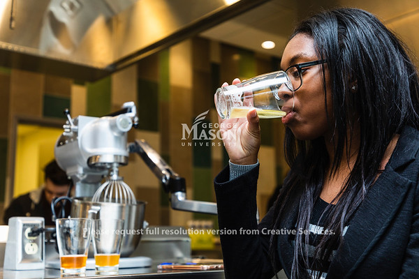 Mason senior Sianna Burnett samples a beer during NUTR 430, Introduction to Wine and Beer. Photo by Lathan Goumas/Strategic Communications
