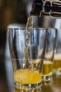 A sample of beer is poured during Kerri Lacharite's NUTR 430 class, Introduction to Wine and Beer.  Photo by Lathan Goumas/Strategic Communications