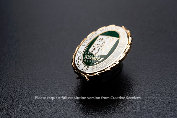 Pin for School of Nursing, College of Health and Human Services.  Photo by:  Ron Aira/Creative Services/ George Mason University