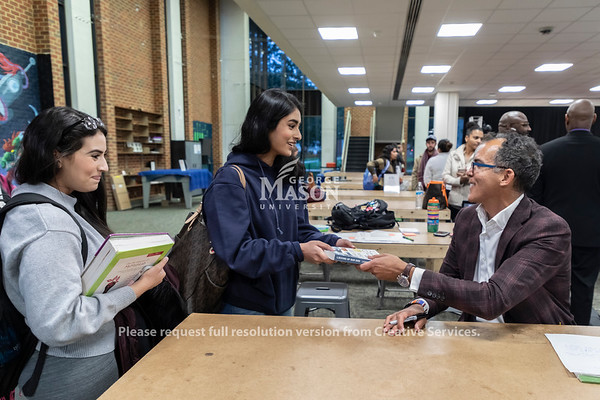 """James Forman Jr. signs copies of his book, """"Locking Up Our Own, Crime and Punishment in Black America,"""" after giving the inaugural Roger Wilkins Lecture. Photo by Lathan Goumas/Strategic Communications"""