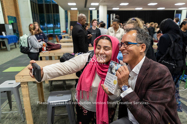 James Forman Jr. takes a selfie with freshman Sohila Hassan after giving the inaugural Roget Wilkins Lecture. Photo by Lathan Goumas/Strategic Communications