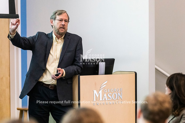 Dr. Karl Hausker, Senior Fellow in the Climate Program at the World Research Institute, discusses the clean energy transition during a lecture at George Mason University.  Photo by Lathan Goumas/Strategic Communications