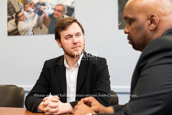 Dominic Straquadine (left) talks with Reginald Allen( right) about the Enviromental Professional Career Network. A new mentorship program designed to connect Environmental Science and Policy students with professionals working in the field. Photo by Lathan Goumas/Strategic Communications