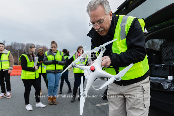 Professor Steven Burmeister sets up an unmanned arial vehicle during his FRSC 516 Forensic Drone Photography class. Photo by Lathan Goumas/Office of Communications and Marketing   Photo Taken:Tuesday, November 19, 2019