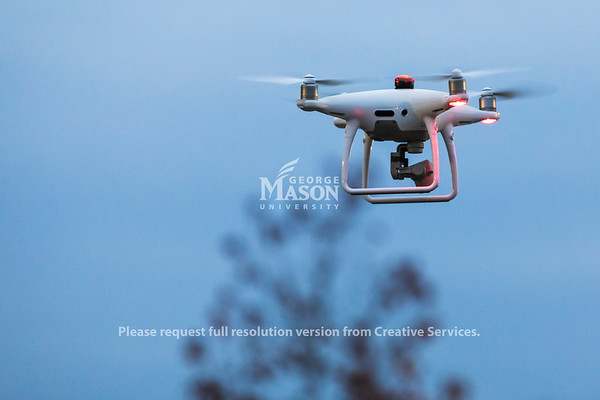 A unmanned arial vehicle flies around a mock car accident during a FRSC 516 Forensic Drone Photography class. Photo by Lathan Goumas/Office of Communications and Marketing   Photo Taken:Tuesday, November 19, 2019
