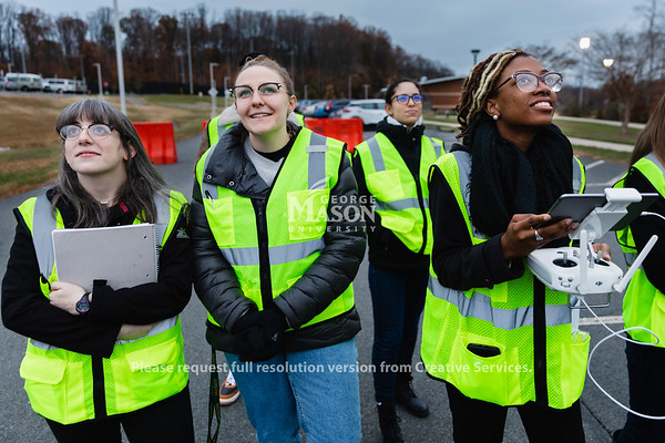 Masters student Taiylor McGhee(right) pilots am unmanned arial vehicle around a mock accident scene during a FRSC 516 Forensic Drone Photography class. Photo by Lathan Goumas/Office of Communications and Marketing   Photo Taken:Tuesday, November 19, 2019