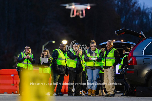 Students in Professor Steven Burmeister's FRSC 516 Forensic Drone Photography class pilot a drone around a mock car accident. Photo by Lathan Goumas/Office of Communications and Marketing   Photo Taken:Tuesday, November 19, 2019