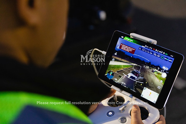 Masters student Ricard Sandoval pilots an unmanned arial vehicle around a mock accident scene during a FRSC 516 Forensic Drone Photography class. Photo by Lathan Goumas/Office of Communications and Marketing   Photo Taken:Tuesday, November 19, 2019