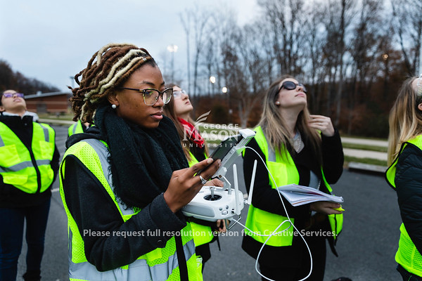 Masters student Taiylor McGhee pilots am unmanned arial vehicle around a mock accident scene during a FRSC 516 Forensic Drone Photography class. Photo by Lathan Goumas/Office of Communications and Marketing   Photo Taken:Tuesday, November 19, 2019