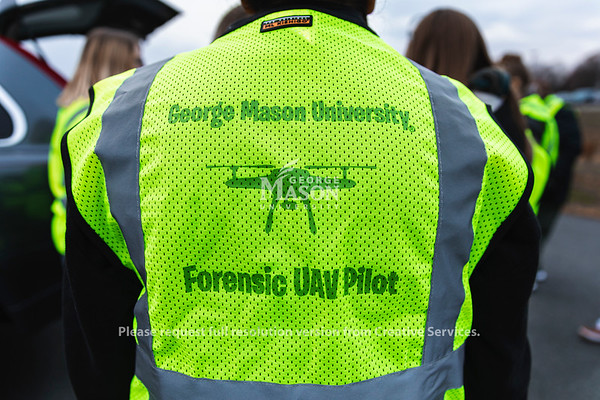 A student in FRSC 516 Forensic Drone Photography wears a safety vest during an exercise at a mock accident scene. Photo by Lathan Goumas/Office of Communications and Marketing   Photo Taken:Tuesday, November 19, 2019