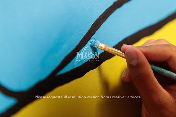 Mason Mural Brigade painting hallway at MBT. Photo by Ian Shiff/Creative Services/George Mason University