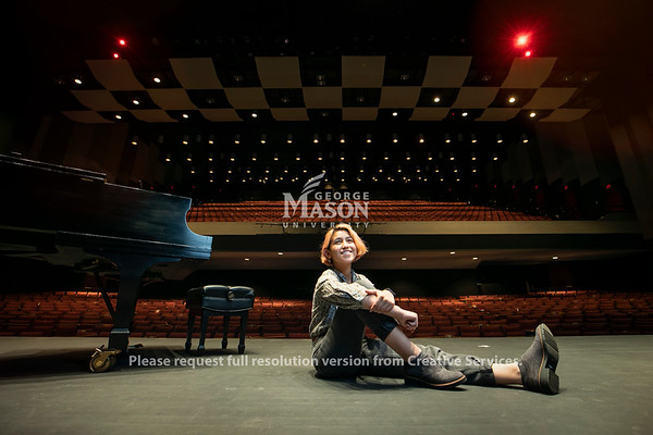 Mason junior Fe Miranda (they/them/theirs) is studying music education at the Reva and Sid Dewberry Family School of Music in order to share the transformative power of the arts with young people.  Photo by:  Ron Aira/Creative Services/ George Mason University.