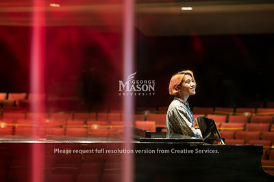 Mason junior Fe Miranda (they/them/theirs) is studying music education at the Reva and Sid Dewberry Family School of Music in order to share the transformative power of the arts with young people.  Photo by:  Ron Aira/Creative Services/ George Mason University
