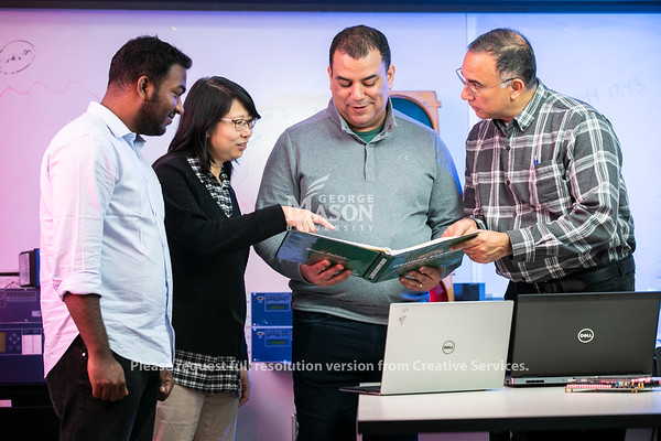 Professor Paulo Costa and students at The Radar and Radio Engineering Lab (RARE Lab), located at Volgenau School of Engineering.  Photo by:  Ron Aira/Creative Services/George Mason University