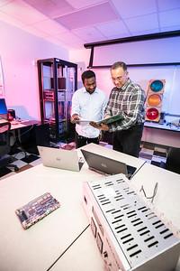 Professor Paulo Costa and student at The Radar and Radio Engineering Lab (RARE Lab), located at Volgenau School of Engineering.  Photo by:  Ron Aira/Creative Services/George Mason University