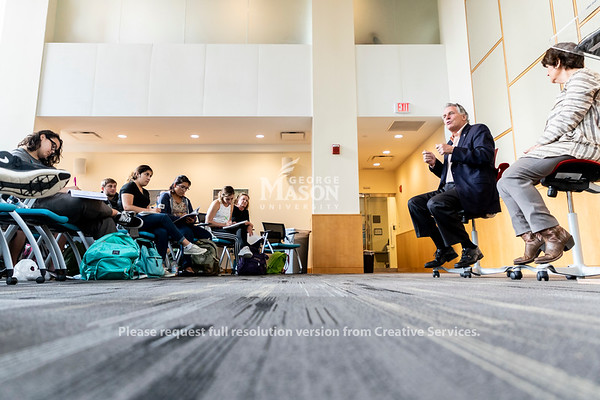 Former Virginia Governor and Distinguished Visiting Professor Terry McAuliffe talks to students in Anne Holton's politics of American education class. Photo by Lathan Goumas/Strategic Communications