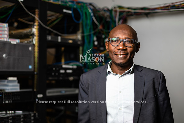 Serge Adouaka-Ngoimale worked with Mason's J.P. Auffret to learn more about information and communication technology during his six-week stay at the university Photo by Lathan Goumas/Strategic Communications