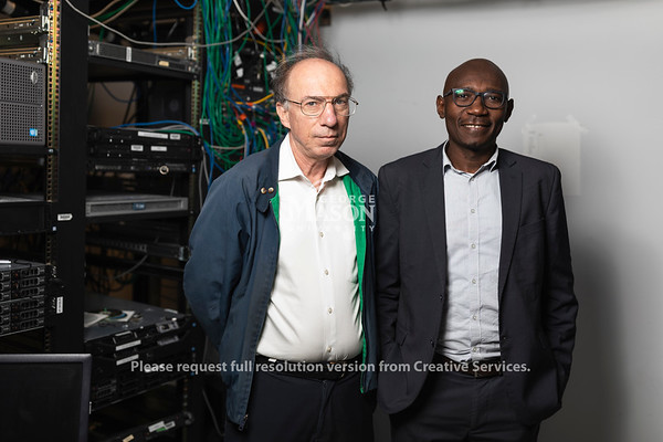 Serge Adouaka-Ngoimale worked with Mason's J.P. Auffret (right) to learn more about information and communication technology during his six-week stay at the university Photo by Lathan Goumas/Strategic Communications
