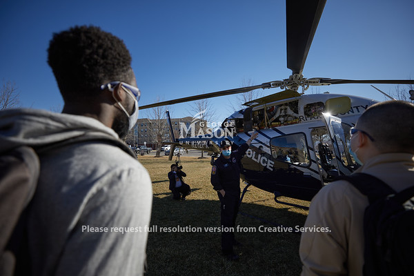Mechanical engineering students learn about the twin engine Bell 429 with the Fairfax County Police Department, Helicopter Division, in Robert Gallo's aeronautics class. Photo By Ian Shiff/Creative Services/George Mason University