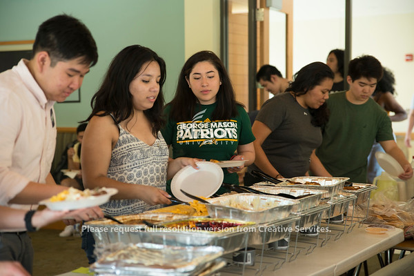 GMU's chapter of the Society of Hispanic Professional Engineers enjoying an end of semester BBQ party together. (Bethany Camp/Creative Services/George Mason University)
