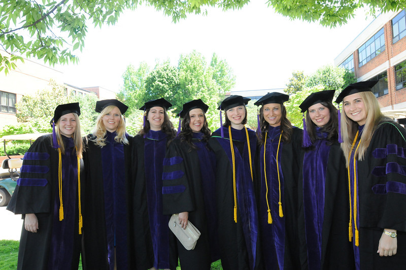 School of Law students posing for the camera before the Convocation ceremony. Photo by Evan Cantwell/Creative Services/George Mason University