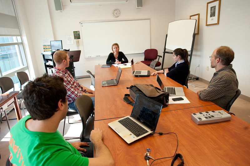 Laurie Neff meets with Mason Law students to discuss cases they are working on through the Law Clinic for Service Members at Arlington Campus. Photo by Alexis Glenn/Creative Services/George Mason University