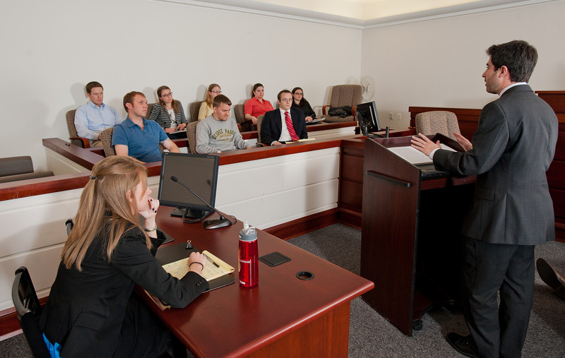 Mason Law students participate in a Trial Moot Court as part of a Trial Advocacy course taught by Professor Robert Wooldridge. The class provides training in the preparation and presentation of evidence in jury and non-jury trials. Photo by Alexis Glenn/Creative Services/George Mason University